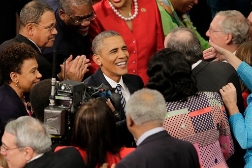 US President Barack Obama arrives on Capitol Hill in Washington, Tuesday, Jan. 12, 2016, to give his State of the Union address before a joint session of Congress. (AP Photo/J. Scott Applewhite)