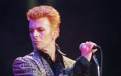 David Bowie performs during a concert celebrating his 50th birthday, at Madison Square Garden in New York, January 9, 1997. (AP Photo/Ron Frehm, File)