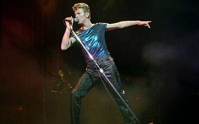 In this September 14, 1995, file photo, David Bowie performs in Hartford, Connecticut. Bowie, the innovative and iconic singer whose illustrious career lasted five decades, died Monday, January 11, 2016, after battling cancer for 18 months. He was 69. (AP Photo/Bob Child, File)