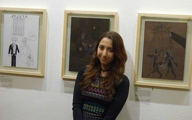 Amit Katz in front of her award-winning cartoon (Eliana Block/Times of Israel)