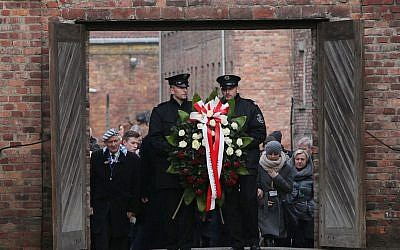 Soldiers hold a wreath at the former Auschwitz Nazi death camp in Oswiecim, Poland on Jan. 27, 2016, at the 71st anniversary of the death camp's liberation by the Soviet Red Army in 1945. (AP Photo/Czarek Sokolowski)