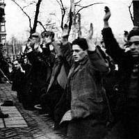 In February of 1941, Amsterdam's Nazi occupiers rounded up 427 Jewish men in their first 'razzia' and deportation from the Netherlands. Only two of the men survived the war. (Wikimedia Commons).