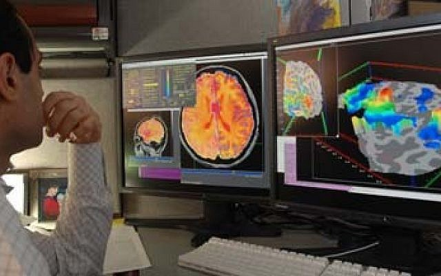 Illustrative image of a researcher checking fMRI images. (Wikimedia commons)