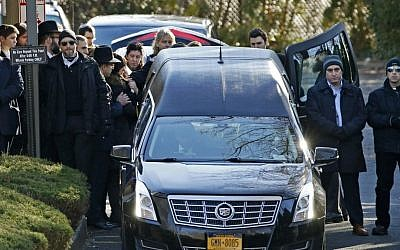 Family members gather at the rear of a hearse carrying the casket during the funeral for Dr. Robin Goldman, a 58-year-old pediatrician found slain inside her multimillion-dollar Scarsdale, NY, home on January 21, 2016. (AP/Kathy Willens)