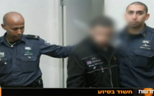 A key suspect in the Nashat Milhem case is remanded on January 10, 2015 (Channel 10 screenshot)