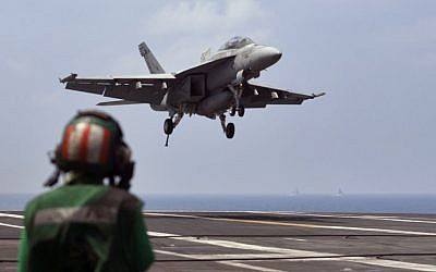 US Navy fighter jet approaching to land on the US Navy aircraft carrier USS Theodore Roosevelt during Exercise Malabar 2015 about 150 miles off Chennai, India, October 17, 2015. (AP/Arun Sankar K., File)