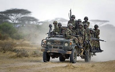 In this Monday, Feb. 20, 2012 file photo, Kenyan army soldiers ride on a vehicle at their base in Tabda, inside Somalia. (AP Photo/Ben Curtis, File)