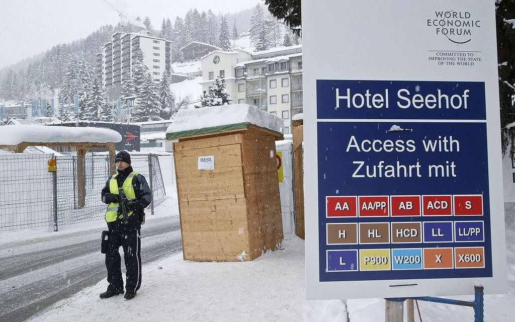 A police officer guards a checkpoint at the Seehof hotel during the World Economic Forum in Davos, Switzerland, Wednesday, January 20, 2016. (AP/Michel Euler)