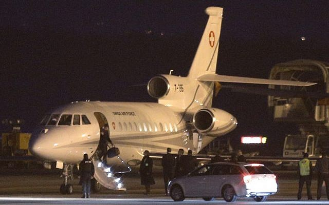 An unidentified man leaves a Dassault Falcon jet of Swiss army at the airport in Geneva, Switzerland, Sunday, January 17, 2016. (AP/Laurent Cipriani)
