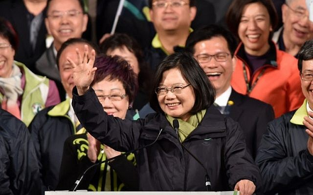 Tsai Ing-wen (center), then president-elect of the Democratic Progressive Party (DPP), waving after her victory in the presidential election in Taipei, January 16, 2016. (AFP/Sam Yeh)