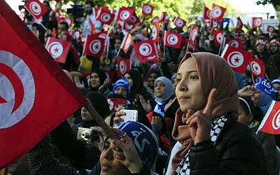 Illustrative: Tunisian women celebrating the fifth anniversary of the Arab Spring in Tunis, Tunisia, on January 14, 2016. (AP/Riadh Dridi)
