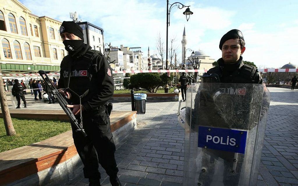 Policemen secure an area at the historic Sultanahmet district, which is popular with tourists, after a suicide bombing that killed 10 in Istanbul, Tuesday, Jan. 12, 2016. (AP Photo/Lefteris Pitarakis)