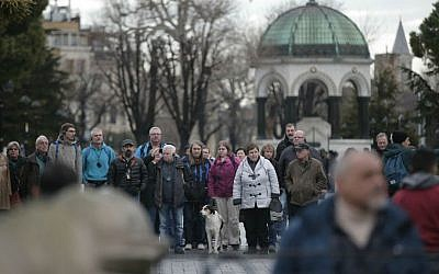 Tourists walk at the site of Tuesday's explosion in the historic Sultanahmet district in Istanbul, Wednesday, Jan. 13, 2016. (AP Photo/Lefteris Pitarakis)