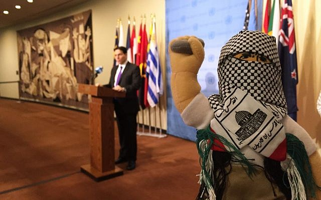 Israel's UN ambassador, Danny Danon, and his colleagues display what he calls 'terror dolls,' right, which he says are being used to teach hatred among Palestinian children, on Tuesday, January 26, 2016, at the UN (AP Photo/Cara Anna)