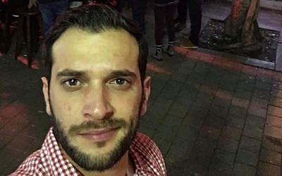 Alon Bakal, one the victims of a January 1, 2016 shooting attack in Tel Aviv, seen outside the Simta bar on December 20, 2015 (Courtesy Facebook)