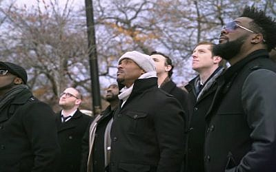 Members of the Maccabeats and Naturally 7 in 'Shed a Little Light' video. (YouTube)