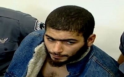 The suspect in the December 1, 2016 shooting attack in Tel Aviv, 29-year-old Nashat Milhem, as seen after a 2007 arrest (Channel 10 news)