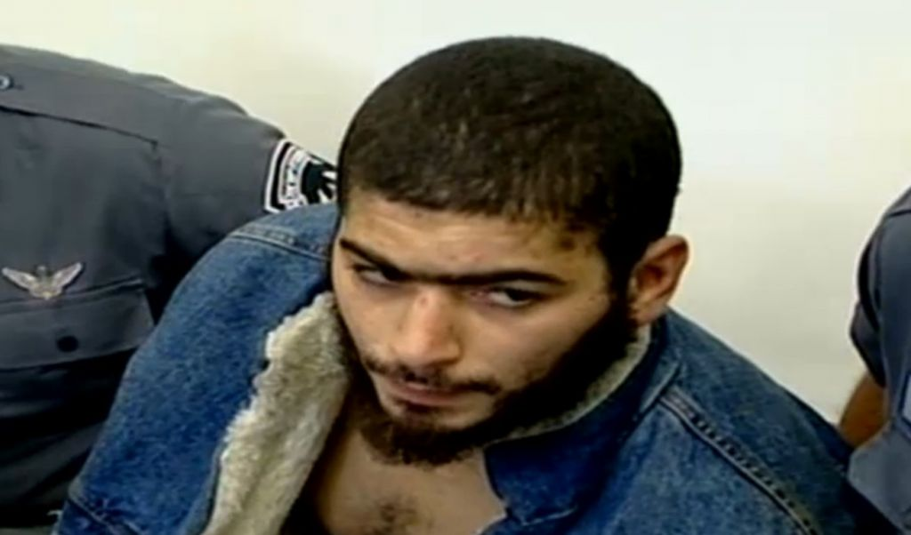 The suspect in the January 1, 2016 shooting attack in Tel Aviv, 29-year-old Nashat Milhem, as seen after a 2007 arrest (Channel 10 news)