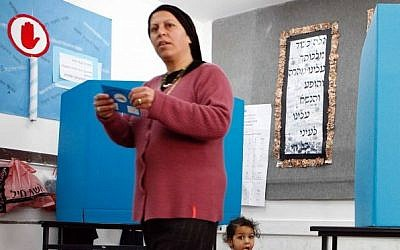 An ultra-Orthodox Jewish woman casts her vote in a polling station on Tuesday, 28 March 2006. (Nati Shohat/Flash90)