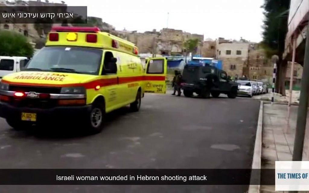 An ambulance at a shooting attack near Hebron's Tomb of the Patriarchs, Sunday, January 3, 2015. (YouTube screenshot)