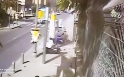 """Footage of Alaa Abu Jamal stabbing passers-by in a Jerusalem terror attack on October 15, 2014. The attack is praised in the song """"Lovers of Stabbing"""" while the clip plays in the background. (screen capture: YouTube)"""