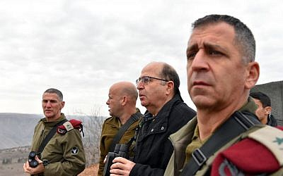 Deputy Chief of Staff Yair Golan speaks with then-Defense Minister Moshe Ya'alon (second from the right) and Northern Command head Aviv Kochavi (right) during a visit to Israel's northern border following a Hezbollah attack the day before, on January 5, 2016. (Ariel Hermoni/Defense Ministry)