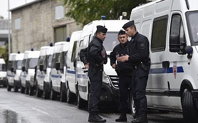 French police conducting an operation in La Courneuve, near Paris, Aug. 27, 2015. (Miguel Medina/AFP/Getty Images, via JTA)