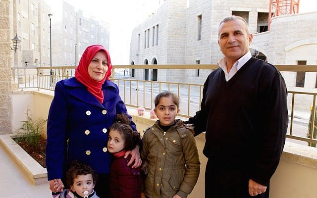 Basim Dodin, right, and his wife Asma are among the first Palestinian residents of Rawabi. (Yardena Schwartz/JTA)