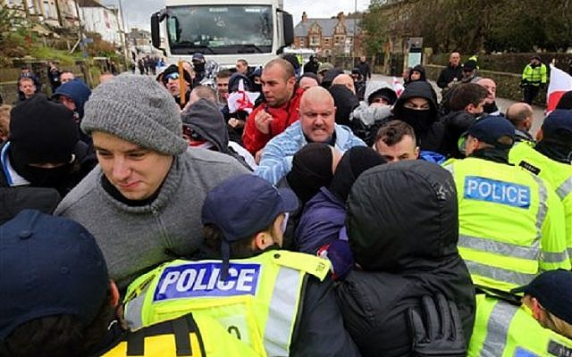 Right-wing protestors push through police lines at an anti-immigration demonstration in Dover, southeastern England, Saturday Jan. 30, 2016. (Gareth Fuller/PA via AP)
