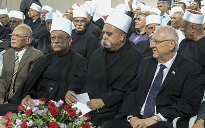 File: President Reuven Rivlin sits with members of Israel's  Druze community, on September 24, 2015.  (Mark Neyman/GPO)