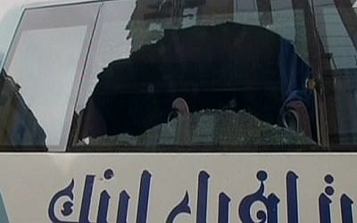 The broken window of a bus used by Arab Israeli tourists following an attack in Cairo on January 7, 2016 (screen capture: Channel 2)