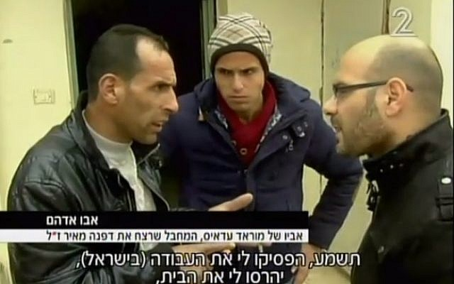 Abu Adham (L), the father of the 15-year-old Palestinian arrested on suspicion of killing Dafna Meir, 38, in her home on January 17, 2016 (screen capture: Channel 2)