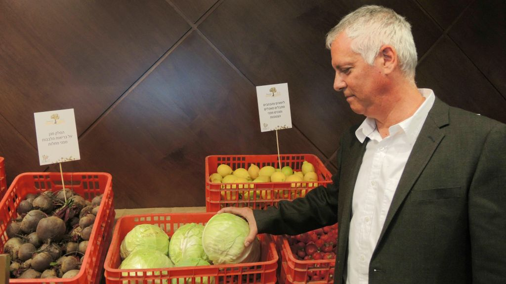 "Gidi Kroch, CEO of Leket Israel, with ""rescued"" food that was deemed to have a blemish or cosmetic issue, on January 6, 2015. About half of Israel's wasted food is completely safe and has full nutritional value. (Melanie Lidman/Times of Israel)"