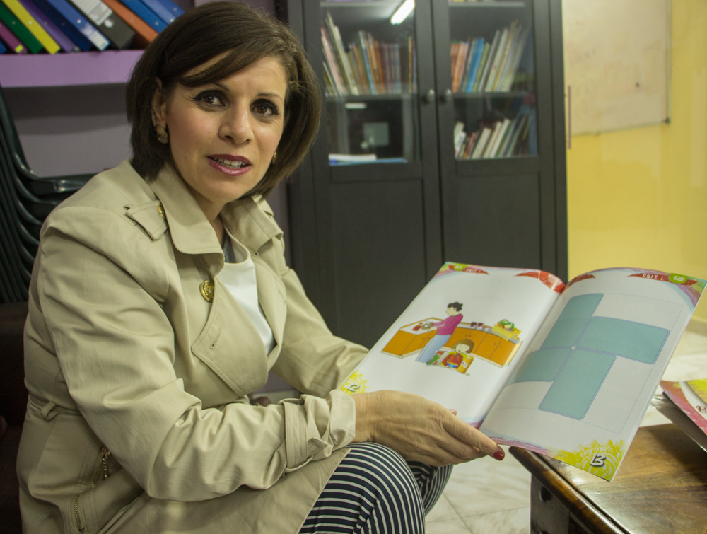 Dalia Fadila in the Tira pre-school, with her book Where's My Family (Courtesy)