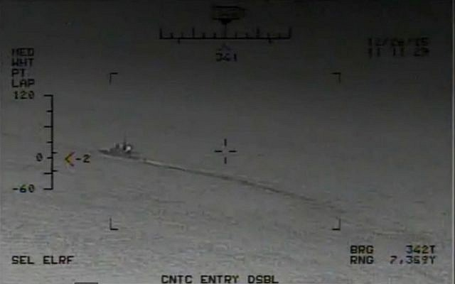 An image from footage released by the US Navy on January 9, 2016, showing Iranian Revolutionary Guard vessels firing rockets near warships and commercial traffic in the Strait of Hormuz in December 2015. (Screen capture: US Navy)