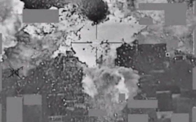 File. An image from a video released by the US Defense Department the American bombing of an Islamic State cash stockpile in Mosul, Iraq on January 11, 2016. (Screen capture: Defense Video & Imagery Distribution System)