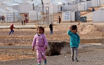 Young Syrian refugees stand at the Azraq refugee camp in northern Jordan on January 30, 2016. (AFP/KHALIL MAZRAAWI)