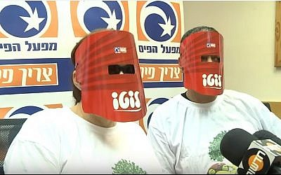 An Israeli couple keep their identities hidden as they collect their lottery winnings in May 2013  (YouTube screen shot)