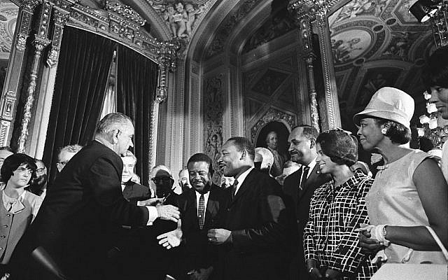 Soon after the passage of the 1965 Voting Rights Act, President Lyndon B. Johnson embraces Dr. Martin Luther King (Wikimedia Commons)