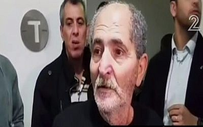 Mohammed Milhem, the father of Tel Aviv gunman Nashat Milhem, speaks to reporters following his release from custody on January 10, 2016 (screen capture: Channel 2)