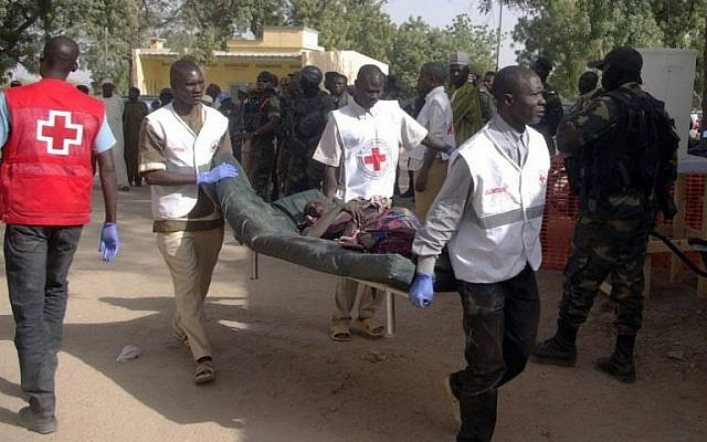 Illustrative: A wounded woman is carried on a stretcher in Mora, following suicide attacks in the border city of Kerawa, northern Cameroon, on January 29, 2016. (AFP, Stringer)