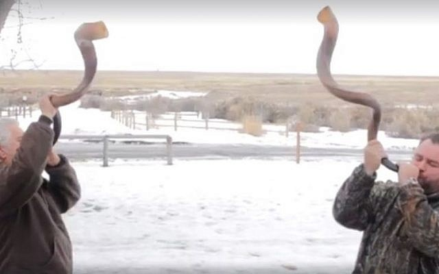 Oregon militia members blow 'battle trumpet' shofars in a video uploaded to Facebook on January 20, 2016. (screen capture: Facebook)