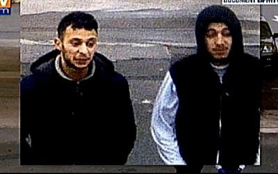 Salah Abdeslam (left), suspected of involvement in the November 13, 2015 terror attacks in Paris with his friend Hamza Attou seen entering a convenience store at 9:45 a.m. on 14 November near the France-Belgium border. (Screen capture: BFM TV)