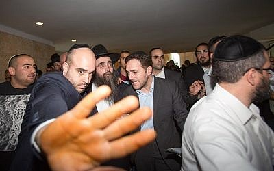 Rabbi Yoshiyahu Pinto, in hat, leaves the Supreme Court in Jerusalem after appealing his sentence, November 16, 2015. (Yonatan Sindel/Flash90)