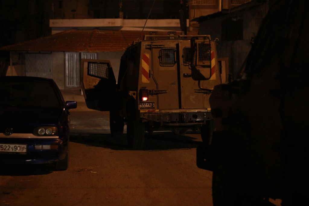 An IDF jeep pulls up to the home of a Palestinian teenager accused of taking part in violent riots just after 2:30 a.m. in the city of Qalqilya on January 14, 2016. (Judah Ari Gross/Times of Israel)