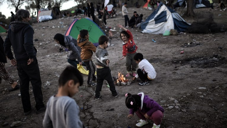 This file photo taken on November 4, 2015 shows refugee and migrant children, living in a field next door to the Moria camp on the Greek island of Lesbos. (AFP / ARIS MESSINIS)