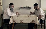 The Shtisels, father Shulem and son Akiva, at their kitchen table (Courtesy: 'Shtisel')