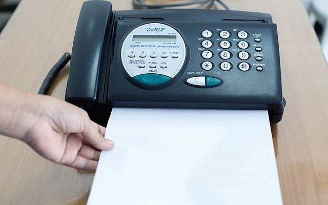 Illustrative image of a fax machine. (via Shutterstock)