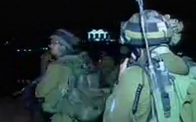 Soldiers searching for an assailant who stabbed a woman to death in the West Bank settlement of Otniel on January 17, 2016. (Screen capture: Channel 2)