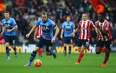 Harry Kane of Tottenham Hotspur is chased by Jordy Clasie (4) and Victor Wanyama of Southampton (12) during the Barclays Premier League match between Southampton and Tottenham Hotspur at St Mary's Stadium on December 19, 2015 in Southampton, England.  (Charlie Crowhurst/Getty Images via JTA)